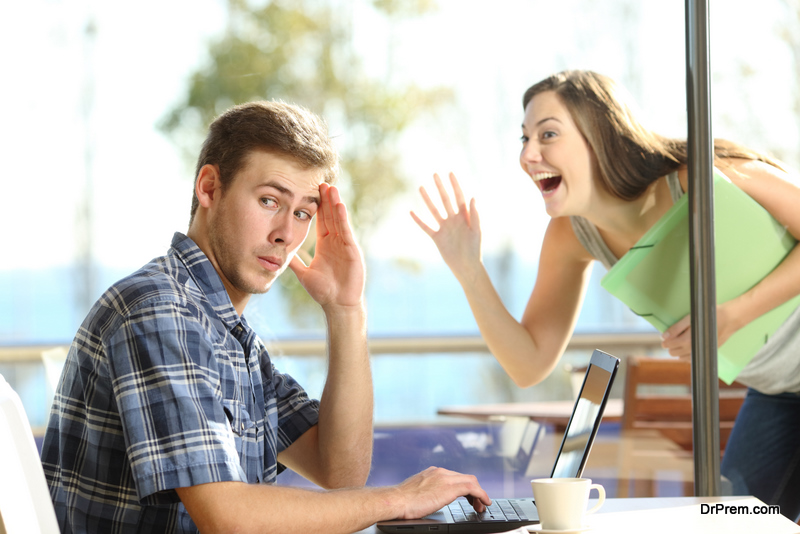woman-distracting-her-partner-in-the-office