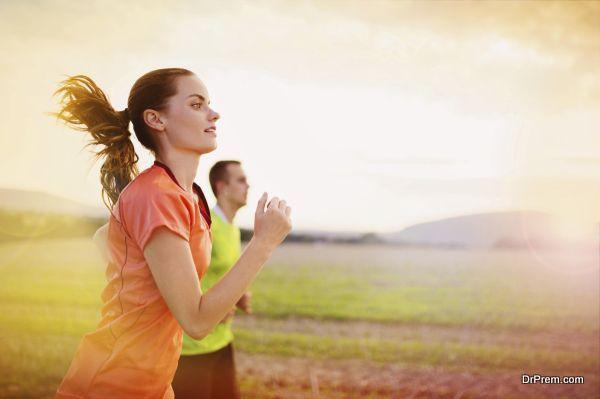 running people at sunset