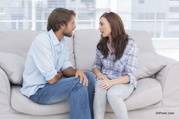 Young couple quarelling in the office of therapist
