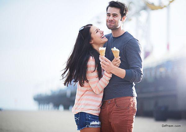 young couple having fun at santa monica pier