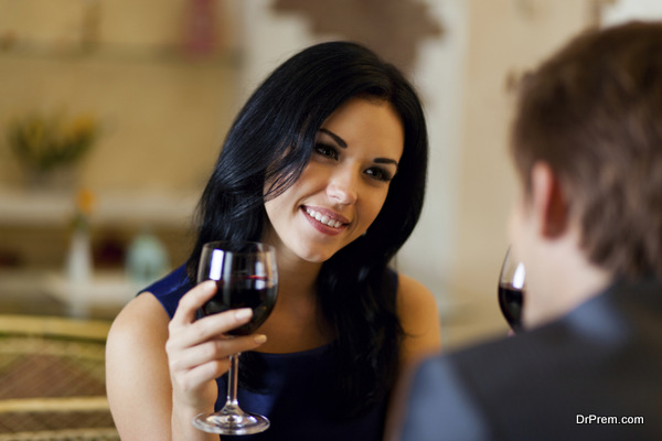 Couple romantic date drink glass of red wine at restaurant