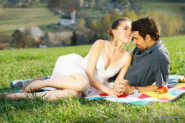 Lovely couple on picnic in mountains