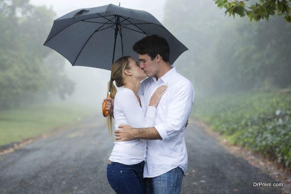 couple kissing under an umbrella