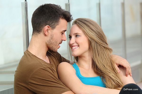 Couple in love looking each other outdoor